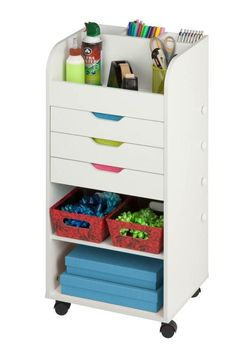 Keep your crafting materials organized with this convenient, rolling storage cart. Featuring three built-in storage drawers and two dowels for hanging ribbon, this storage center is ideal for storing crafting supplies or gift wrapping necessities. Built In Shelves, Built In Storage, Storage Shelves, Locker Storage, Craft Storage Drawers, Craft Storage Cabinets, Cardboard Storage, Ribbon Storage, Basement Storage