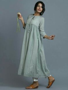 Sea Green Cotton Front Tie Up Kurta with Printed Slip Stylish Dresses, Simple Dresses, Casual Dresses, Fashion Dresses, Simple Kurti Designs, Kurta Designs Women, Indian Designer Outfits, Designer Dresses, Indian Dresses