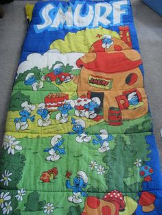 I think I had one as a child. Don't remember exactly what was on the sleeping bag.  Vintage SMURFS sleeping bag 80s