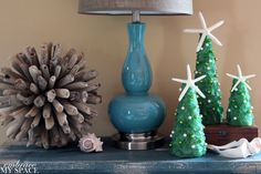 Fun coastal Christmas decorations by   Embrace My Space blog. Driftwood ball from HomeGoods!