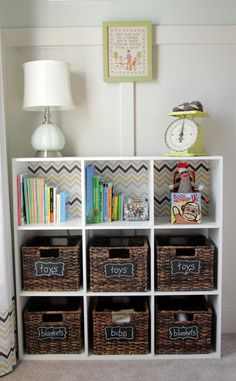 DIY: dressing up standard cubbies with chevron fabric {notice the white curtains on the left, which have a band of the same chevron fabric}, cute chalkboard labels on baskets, DIY board + batten wall treatment