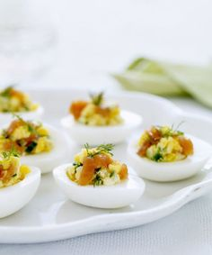 EGGS STUFFED WITH SMOKED SALMON AND CUCUMBERS Deviled eggs are a timeless brunch tradition. Impress guests by adding smoked salmon, mayo, and dill to this hassle-free recipe. Click through for more Mother's Day brunch and breakfast recipes.
