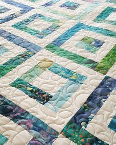 A beautiful blue and green batik quilt by Julie B!