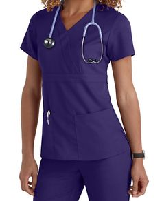 FITTED AND FABULOUS Get ready to take on the most challenging workplace wearing this spin on a sleek mock-wrap scrub. With two back tabs, fitted seams, a banded empire waist, and seriously soft fabric, this top takes you where form and function add up to spot-on style. Grey's Anatomy 3 Pocket Mock Wrap Scrub Tops Mock wrap Banded empire waist with side-seam tabs Adjustable button closures at the back Three pockets, including two patch pockets and an instrument pocket 77% polye...