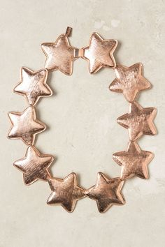 rose gold star necklace via Anthropologie