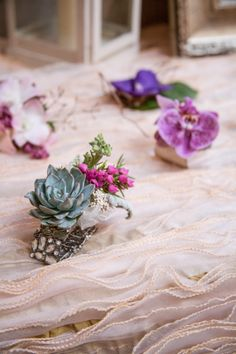 Succulents accented with delicate orchid blooms make a perfect corsage. Photo by: @Jocelyn Carasco Photography