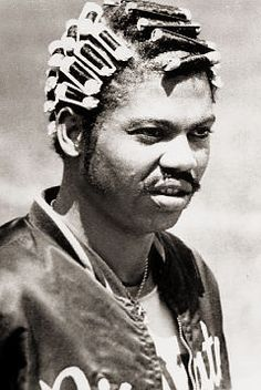 Dock Ellis. Threw a no-hitter in 1970 on LSD. Collaborated with future poet laureate, Donald Hall, on Dock Ellis in the Country of Baseball. Wore curlers before pitching so as to collect sweat to throw spitballs. Subject of the film, No No--A Dockumentary https://www.youtube.com/watch?v=YIZ5TXjnml4
