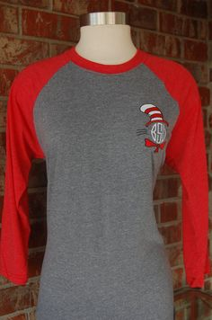 This listing is for a red sleeved/heather bodied henley tee with cat in the hat monogram frame with your choice monogram font. The tee is made of