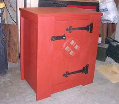 using a medieval storage cabinet (like a pie pantry) to create a non-electrical 'fridge'.