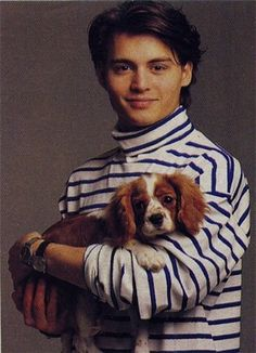too much cuteness for one picture....Johnny Depp holding a pup. Wish he wasn't wearing that turtleneck tho...can't win em' all.