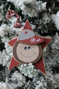 This listing is for a Buckeye Christmas tree ornament. The Ohio State ornament has been cut from wood and hand painted. This would be a great gift for a Buckeye fan. The ornament measures approximately tall. Ohio State Decor, Ohio State Wreath, Ohio State Crafts, Diy Christmas Ornaments, Christmas Bulbs, Buckeye Crafts, Handmade Christmas Decorations, College Football, Alabama Football