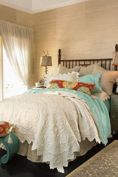 colored sheets and white coverlet...so pretty and calming