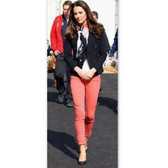 Coral skinny jeans and navy blazer.