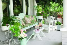 Mint and white furniture on a cozy, cottage front porch. #home #interior #cottage