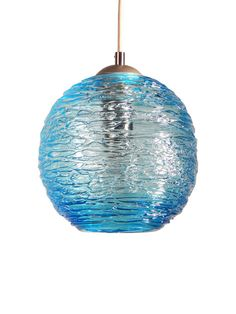 You are viewing a OOAK blown glass pendant lamp. This lamp is textured with a spun glass exterior. Clear glass over an aqua base.  I especially love the shadows that it casts!  Specs:  Globe Sizes: 6, 7, and 8 round Cord- Textile cloth colored: Black, Gray, Silver, Bronze or Champagne ( please specify in Notes section on your invoice) Socket- Nickel or Antique Bronze over Porcelain Socket Bulb: Standard E26 bulb. Candelabra bulbs are used for the 6 globes. Hardware: Brushed Nickel, Antique…