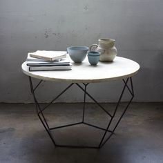 """Loving the origami lines of this table base"" --@Rayan Turner / The Design Confidential"