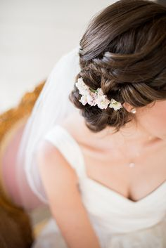 gorgeous understated updo with small flowers