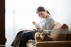 Stock Photo : Woman with dogs sewing on the sofa