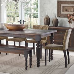 The Valerie Table and Valerie Kitchen Bench both in Barnwood. Both pieces are also available in Driftwood, Rustic Grey, and Off White. #GrainWood #Furniture