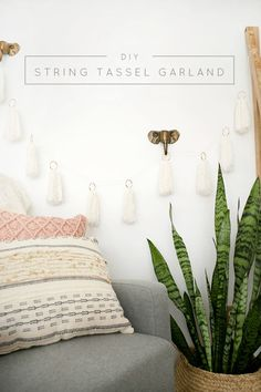 How to Make Easy DIY String Tassel Garland perfect for a boho nursery!