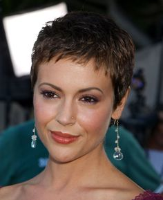 """The theme of surprise celeb haircuts this weekend is now definitively """"short hair, don't care."""" Well, at least if actress Alyssa Milano has anything to say about it (ICYMI: Hilary Duff also cropped her hair within the last 24 hours). The star took to Instagram on Saturday with a chic beauty counter selfie (we're still eyeing all that luxe makeup) featuring her newly shorn pixie cut. She later posted another selfie with her glam squad team members, Linh Nguyen and Scott Patric. Short hair…"""