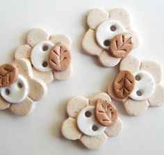 Button Sandstone Flowers Handmade polymer clay buttons ( 5 ). $7.50, via Etsy.