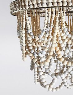 Buy the Mila Chandelier from Marks and Spencer's range. Everything Is Illuminated, Beaded Chandelier, Chandeliers, Coastal Lighting, Natural Wood Finish, Lampshades, Beautiful Interiors, Light Shades, Soft Colors
