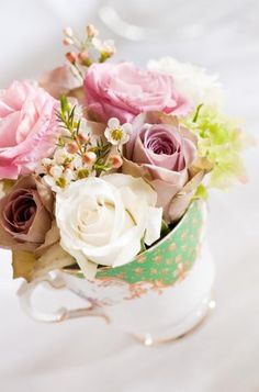pretty and little flower arrangement in a teacup