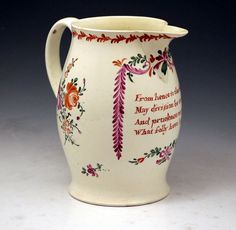 18th century English pottery creamware pitcher with verse, ca. 1780  From hence to the deep   May division be tost   And prudence recover   What folly have lost