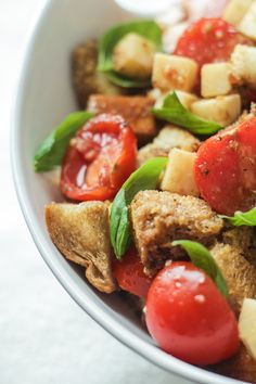 Caprese Panzanella (Bread Salad) - Tomatoes, Basil, and Mozzarella with buttery toasted bread and a savory balsamic dressing.