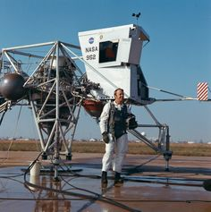 December 14, 1970 — In a classic test pilot pose, Apollo 14 astronaut Alan Shepard stands near a Lunar Landing Training Vehicle before a test flight at Ellington Air Force Base in Houston, Texas.