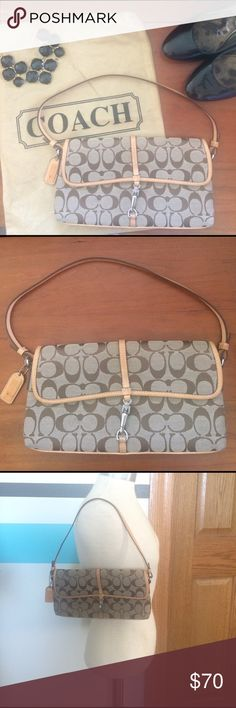 """Coach Signature Demi Clip Flap Shoulder Purse Bag Coach Signature Monogram Demi Clip Flap Shoulder Purse Bag Signature Canvas material  Tan brown color 10.5""""L x 1.25""""H x 13.25""""W  Zipper pocket inside In very good condition Does have bite marks on only the Leather tag (see picture) Comes with dust bag Please ask any questions  💲Open To Offers💲 🚫No Trades🚫 📦Ask About Bundle Discounts💰 Coach Bags Shoulder Bags"""