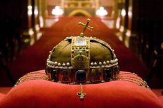 The Holy Crown of Hungary is actually two joined pieces: The corona græca is identical to crowns of Byzantine empresses. Given by Emperor Michael Dukas VII to King Géza's wife, who was of the Greek Synodenos family, around 1075, the gift was an old crown designed for a woman that had to be selected from the Emperor's treasury and remodelled. The corona latina is not an independent object, as it has no function alone. Designed to be attached to the top rim of the Corona Græca to form a…