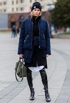 Street-style shot of woman wearing patent over-the-knee boots and puffer jacket   ASOS Fashion & Beauty Feed