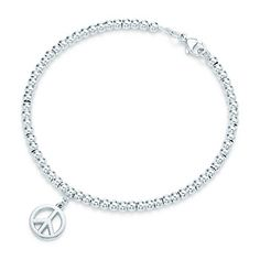 Tiffany & Co. | Item | Peace Sign mini tag in sterling silver on a bead bracelet, medium. | United States
