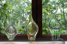 Rausku (Ray fish) glass art sculptures by master glassblower Kari Alakoski by the window at the gallery next to the glass studio in Riihimäki.