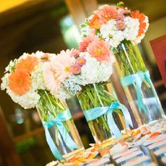 Tiffany blue and coral (loose arrangements - coral, white, pink) with a touch of tiffany blue accents