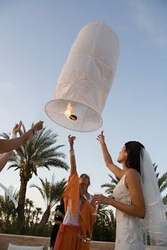 Ceremony SKY LANTERNS!!!! The HOTTEST new trend for your wedding ceremony, vow renewal and rehearsal dinner!