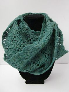 This delightful lightweight scarf is lovingly crocheted from 100% Peruvian Highland Wool interestingly dyed in a mix of green, blue, and teal.