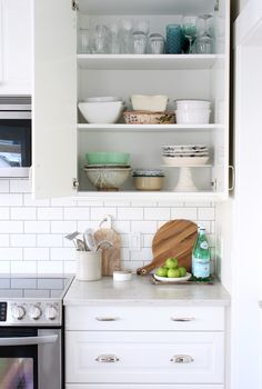 Organized IKEA White Kitchen - Tips for organizing the kitchen cabinets and drawers.