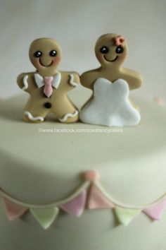 Gingerbread bride and groom wedding cake  - https://www.facebook.com/zoesfancycakes