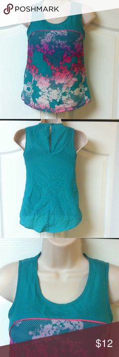 L'amour Nanette Lepore tank Beautiful summer tank! Light and airy; 100% polyester. Button and loop closure at the top if the keyhole back. Pre loved in good condition! Nanette Lepore Tops Tank Tops