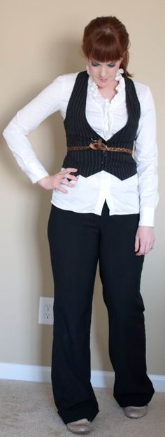 Brown belt over a pinstriped black vest outfit