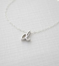 Cursive Initial Necklace 1160 van OliveYewJewels op Etsy (either silver or rose gold)