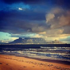 Turbulant skies over Table Mountain. Photo by Shane Killeen. Dorset Travel, Weymouth Beach, Table Mountain Cape Town, South African Flag, Cape Town South Africa, Africa Art, People Of Interest, Beach Town, Beautiful Beaches