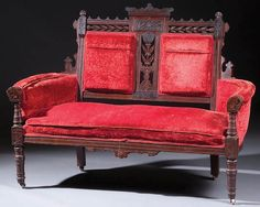 AN EASTLAKE VICTORIAN WALNUT SETTEE last quarter 19th century, with reticulated and carved decoration.