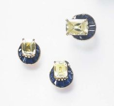 A SET OF RETRO YELLOW AND BLUE SAPPHIRE JEWELRY, BY VAN CLEEF & ARPELS  Comprising a ring, set with a rectangular-cut yellow sapphire, within a calibré-cut sapphire demi-surround; and a pair of ear clips en suite, mounted in gold, (one sapphire on ring deficient), circa 1940 Signed Van Cleef & Arpels NY, no. 27054-2 (