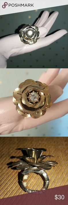 Beautiful Betsey Johnson Gold Flower ring Huge! Gorgeous Betsey Johnson flower ring with large faux diamond in the middle. This is a vintage piece, purchased at Macy's many years ago and worn a few times. Ring has elastic band so on size fits most. Cool statement piece! Betsey Johnson Jewelry Rings