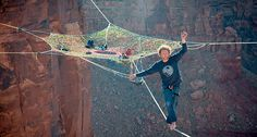 Guys hang huge hammock in the middle of 400-foot-high canyon void in Moab, Utah