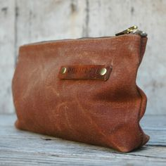 Medium pouch perfect for pens, pencils, cell phone, small journals, lip balm, &c. The waxed canvas will likely outlast your lifetime, but breaks in, looking